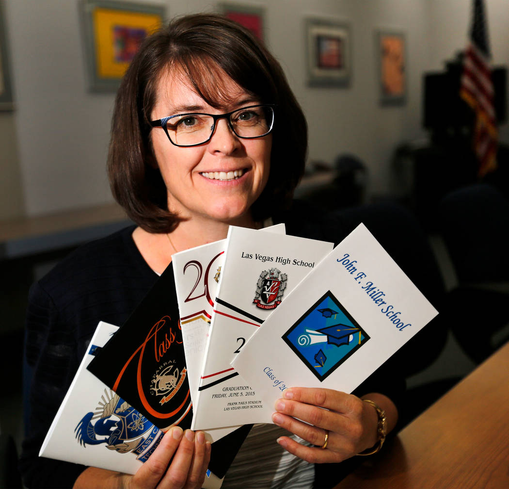 Erin Cranor, a member of the Clark County School Board, District G, shows part of her high school graduation program collection at Edward Greer Education Center in Las Vegas, Thursday, Aug. 10, 20 ...