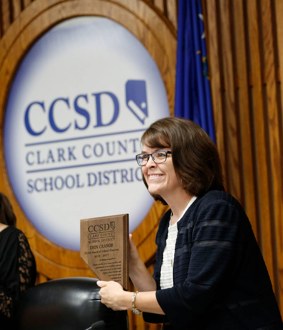 Erin Cranor, a member of the Clark County School Board, District G, receives a plaque during her last meeting as a board member at Edward Greer Education Center in Las Vegas, Thursday, Aug. 10, 20 ...