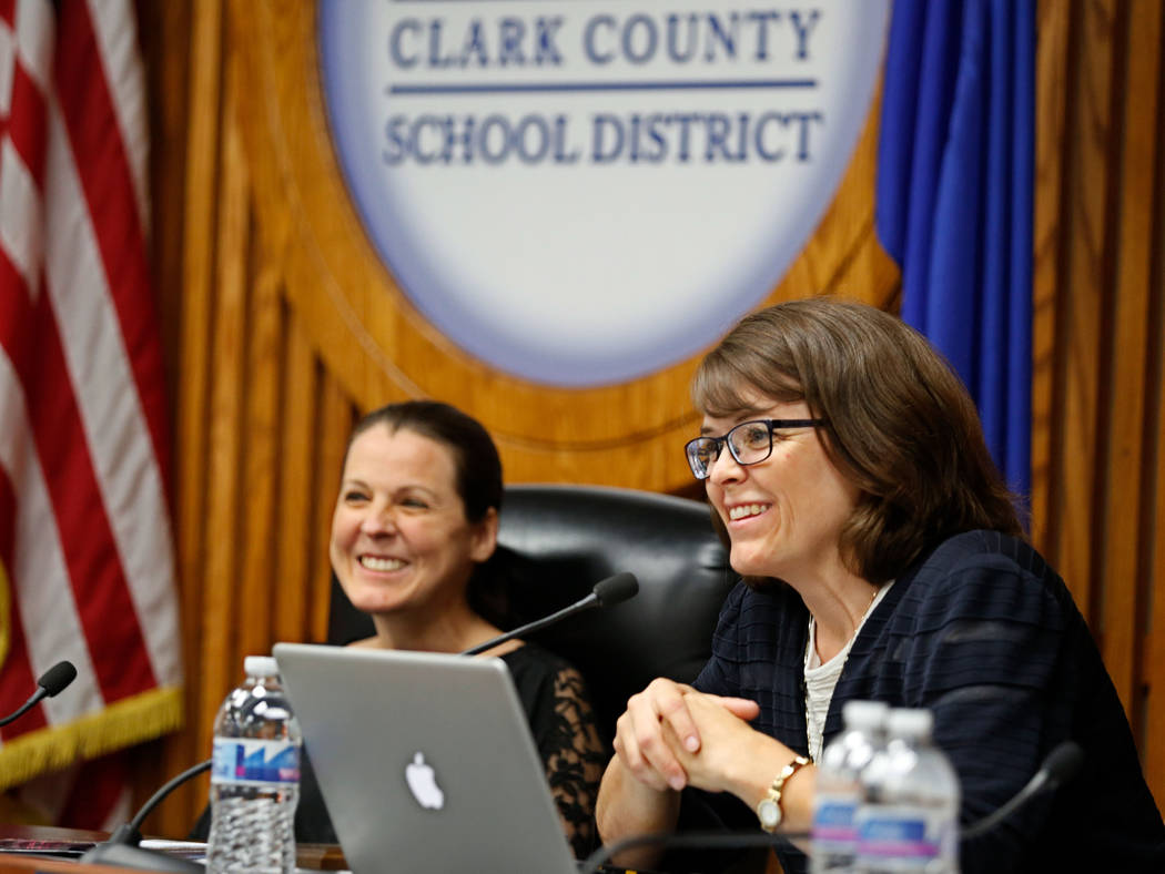 Erin Cranor, left, a member of the Clark County School Board, District G, center, right, speaks during her last meeting as a board member at Edward Greer Education Center in Las Vegas, Thursday, A ...