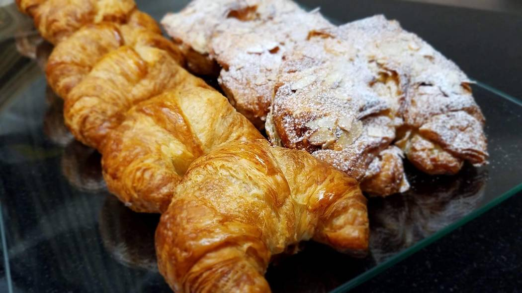 Plain and almond-rum croissants at Alfredo's Patisserie, which opened in early May. (Courtesy photo)