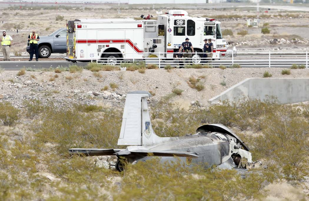 A vintage military plane crashed half a mile south of Volunteer Boulevard near the Henderson Executive Airport on Monday, July 24, 2017. Bizuayehu Tesfaye Las Vegas Review-Journal @bizutesfaye