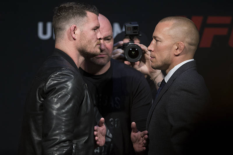 Michael Bisping, left, and George St-Pierre during an UFC press conference for their future fight, at T-Mobile Arena on Friday, March 3, 2017, in Las Vegas. (Erik Verduzco/Las Vegas Review-Journal ...