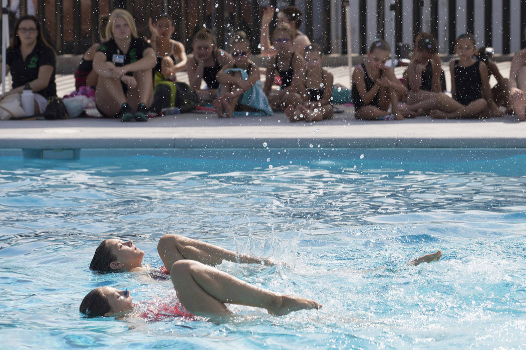 Children flip kick twirl at las vegas synchronized for Pool show vegas