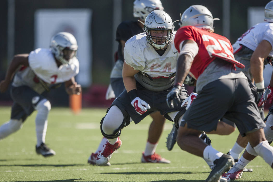 UNLV offensive lineman Nathan Jacobson, center, prepares to block defensive back Trey Austin while scrimmaging during training camp at Rebel Park on Monday, Aug. 14, 2017.  Patrick Connolly Las Ve ...