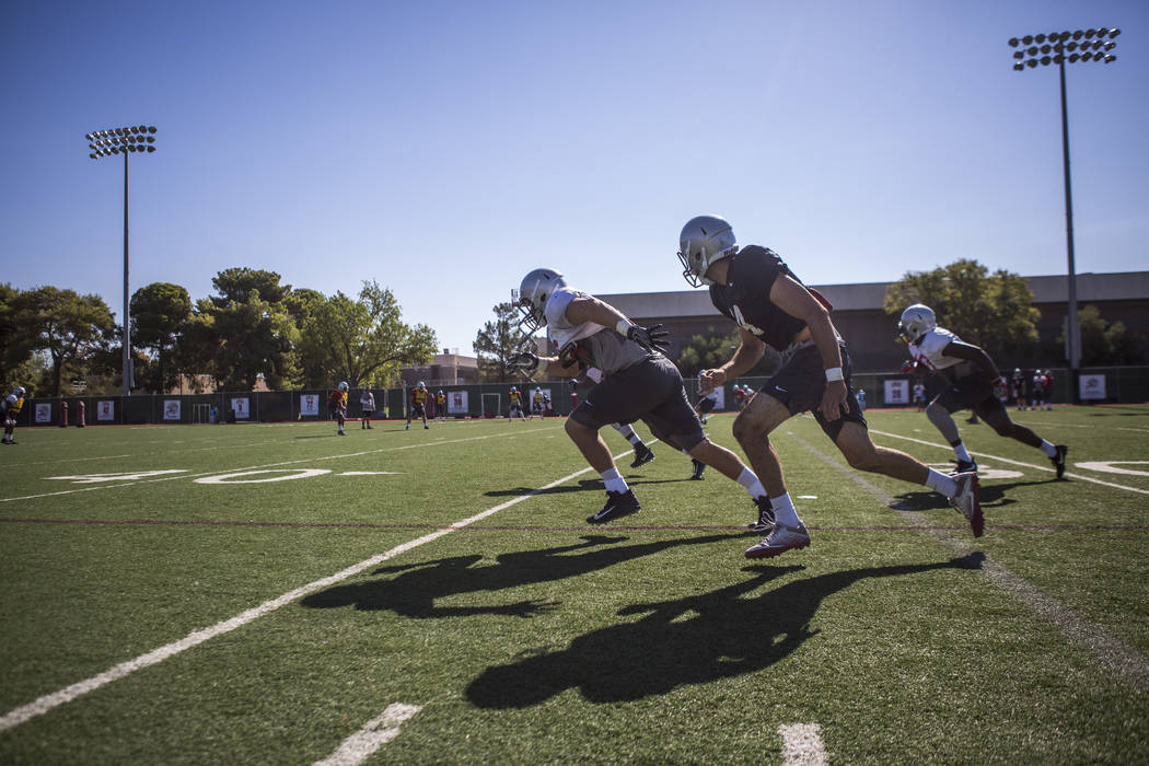 UNLV quarterback Kurt Palandech runs with offensive linemen while practicing offside kicks during training camp at Rebel Park on Monday, Aug. 14, 2017.  Patrick Connolly Las Vegas Review-Journal @ ...