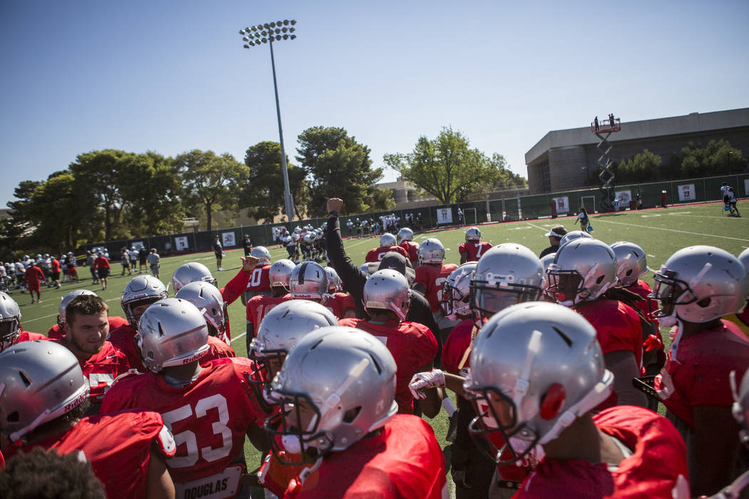 The UNLV defense comes together for a huddle during training camp at Rebel Park on Monday, Aug. 14, 2017.  Patrick Connolly Las Vegas Review-Journal @PConnPie