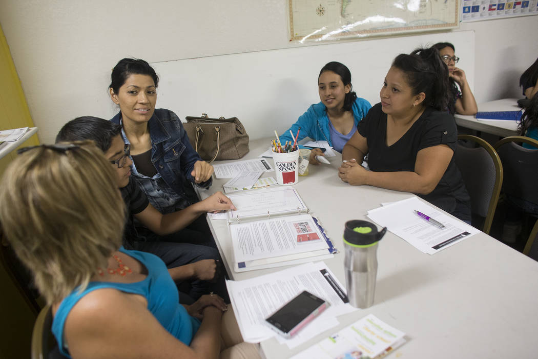Lizbeth Ruiz, from left, Isaias Manrique, 13, Maggie Manrique, Maria Mendoza, and Claudia Ceniceros chat at an introduction to home-school session put on by RISE on Thursday, May 25, 2017, at the  ...