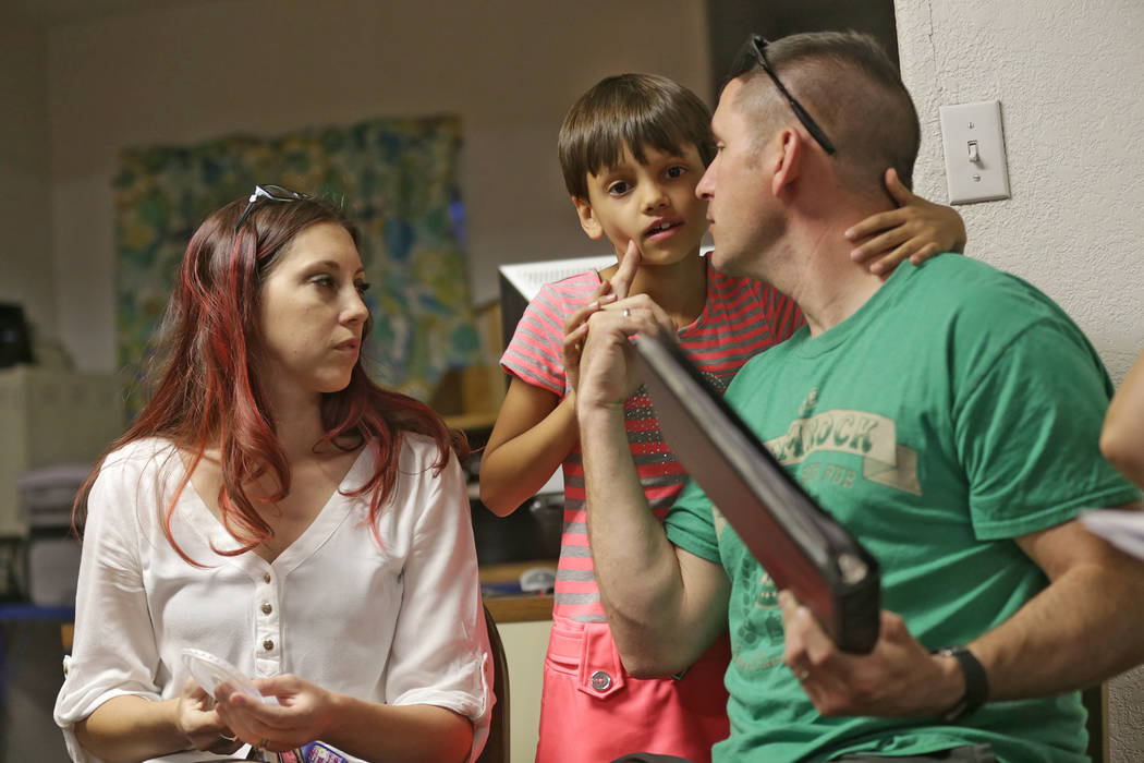 Jamie Cothran, from left, her daughter Mia, 8, and husband Nate at an introduction to home-school session on Thursday, May 25, 2017, at the RISE Resource Center in Las Vegas. Rachel Aston Las Vega ...