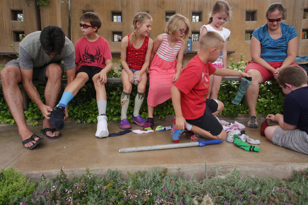 Students from Wise Owls, a home-school group, put socks over their shoes for a botany lesson about seeds at Springs Preserve on Thursday, June 8, 2017, in Las Vegas. Rachel Aston Las Vegas Review- ...
