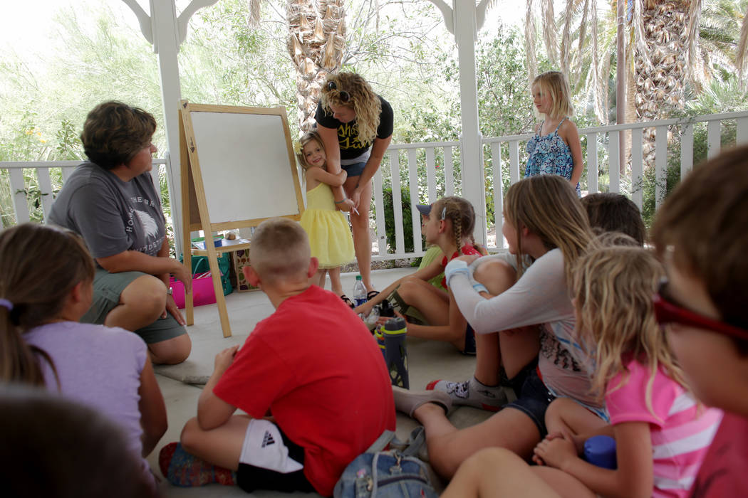Laura Runco helps her daughter Lily Runco, 4, introduce herself to the a home-school group called Wise Owls at Springs Preserve on Thursday, June 8, 2017, in Las Vegas. Rachel Aston Las Vegas Revi ...
