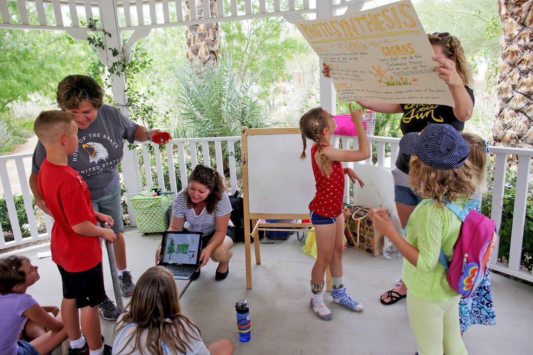 Laura Runco holds a poster for botany lesson to a home-school group called Wise Owls at Springs Preserve on Thursday, June 8, 2017, in Las Vegas. Rachel Aston Las Vegas Review-Journal @rookie__rae