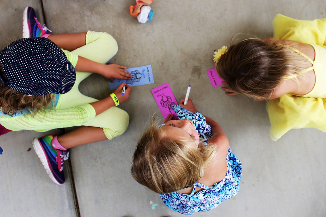 Frankie Feher, 6, from left, Olivia Runco, 7, and Lily Runco, 4, fill out papers for a botany lesson on Thursday, June 8, 2017, at Springs Preserve in Las Vegas. They are a part of a home-school g ...