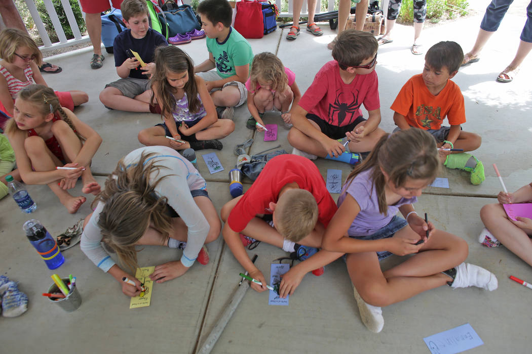 Students from Wise Owls, a home-school group, fill out papers for a lesson about botany at Springs Preserve on Thursday, June 8, 2017, in Las Vegas. Rachel Aston Las Vegas Review-Journal @rookie__rae