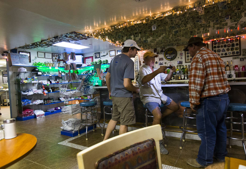 Volunteer Steve Delaney, center, checks his flashlight while preparing for the Extra Terrestrial Full Moon Midnight Marathon in the Little A'Le'Inn in Rachel on Saturday, Aug. 5, 2017. (Chase Stev ...