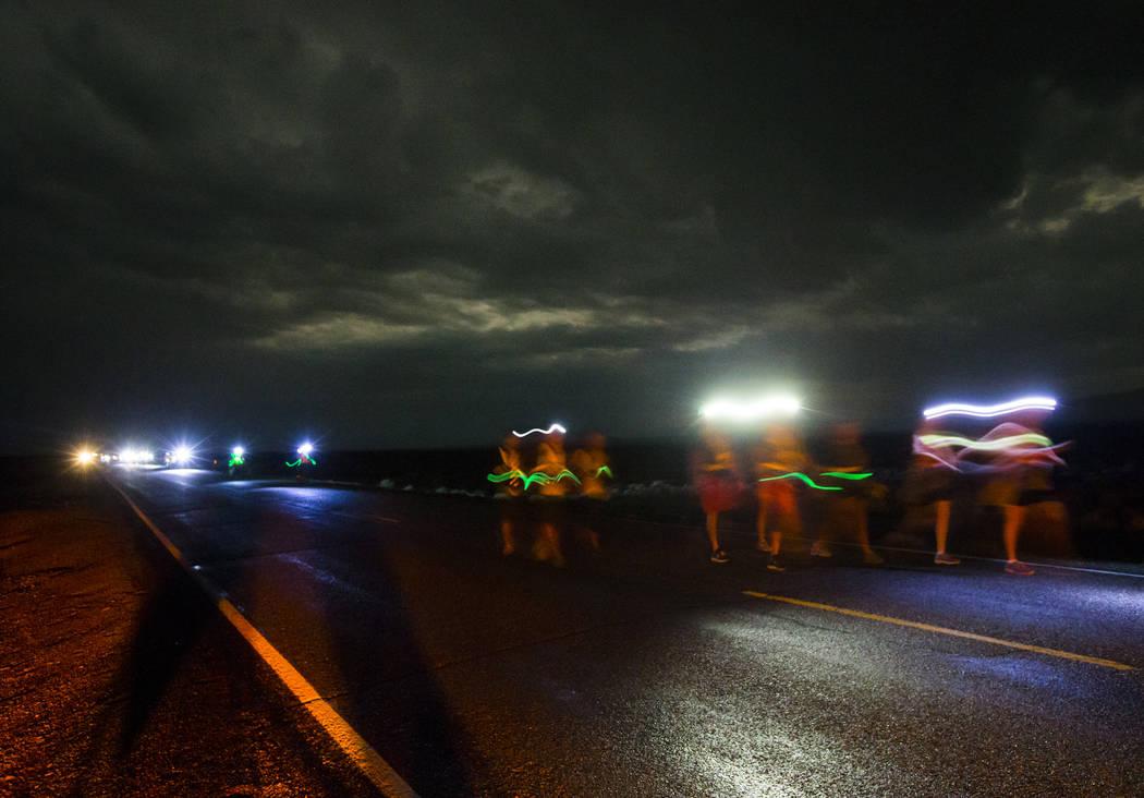 People participate in the Extra Terrestrial Full Moon Midnighthalf marathon near Rachel on Saturday, Aug. 5, 2017. (Chase Stevens/Las Vegas Review-Journal) @csstevensphoto