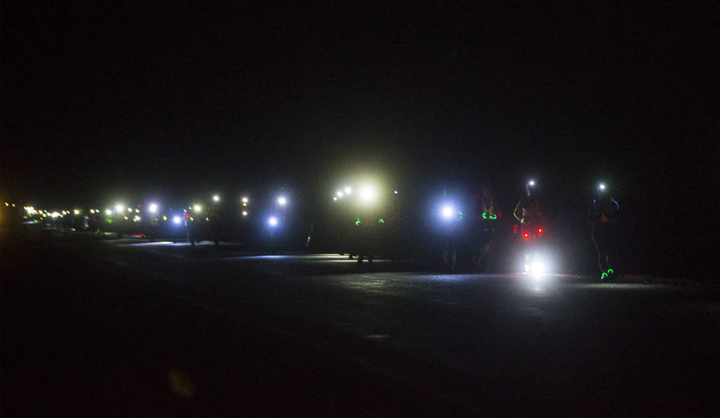 Participants compete in the half and full marathon during the Extraterrestrial Full Moon Midnight Marathon near Rachel on Sunday, Aug. 6, 2017. The event featured five distances ranging from 5k to ...
