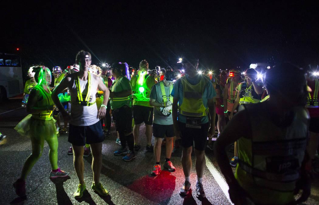 People prepare for the Extra Terrestrial Full Moon Midnight half marathon near Rachel on Saturday, Aug. 5, 2017. (Chase Stevens/Las Vegas Review-Journal) @csstevensphoto