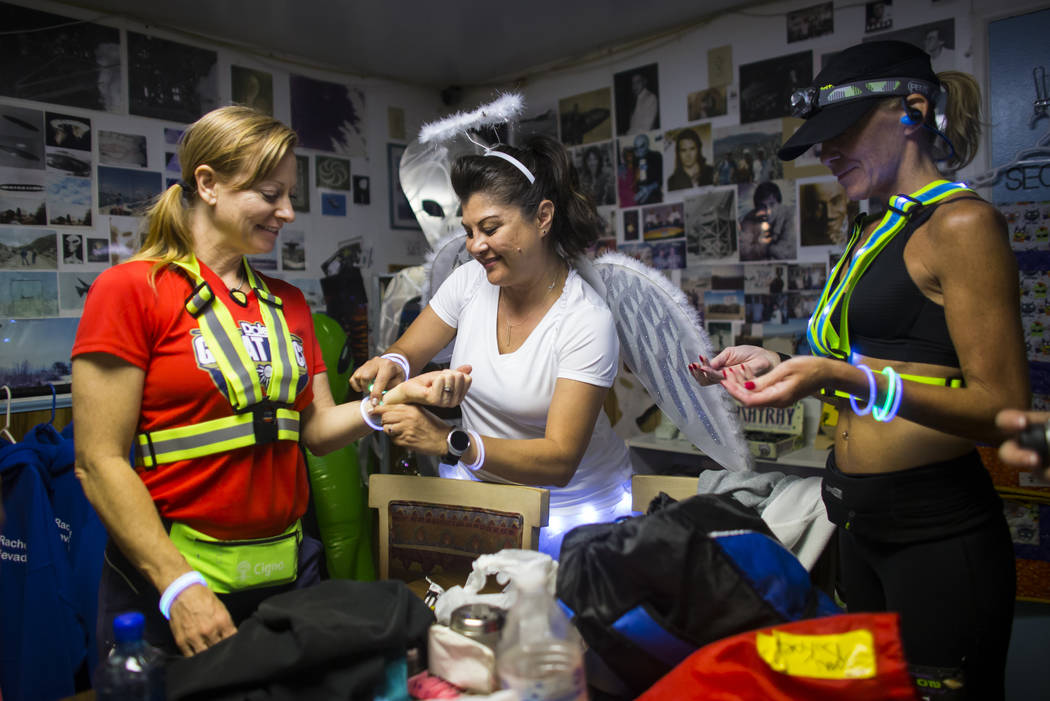 Participants, from left, Sarah Beck of Las Vegas, Lisa Anderson of Los Angeles and Shannon Carr of Las Vegas prepare for the Extraterrestrial Full Moon Midnight Marathon in Rachel on Saturday, Aug ...