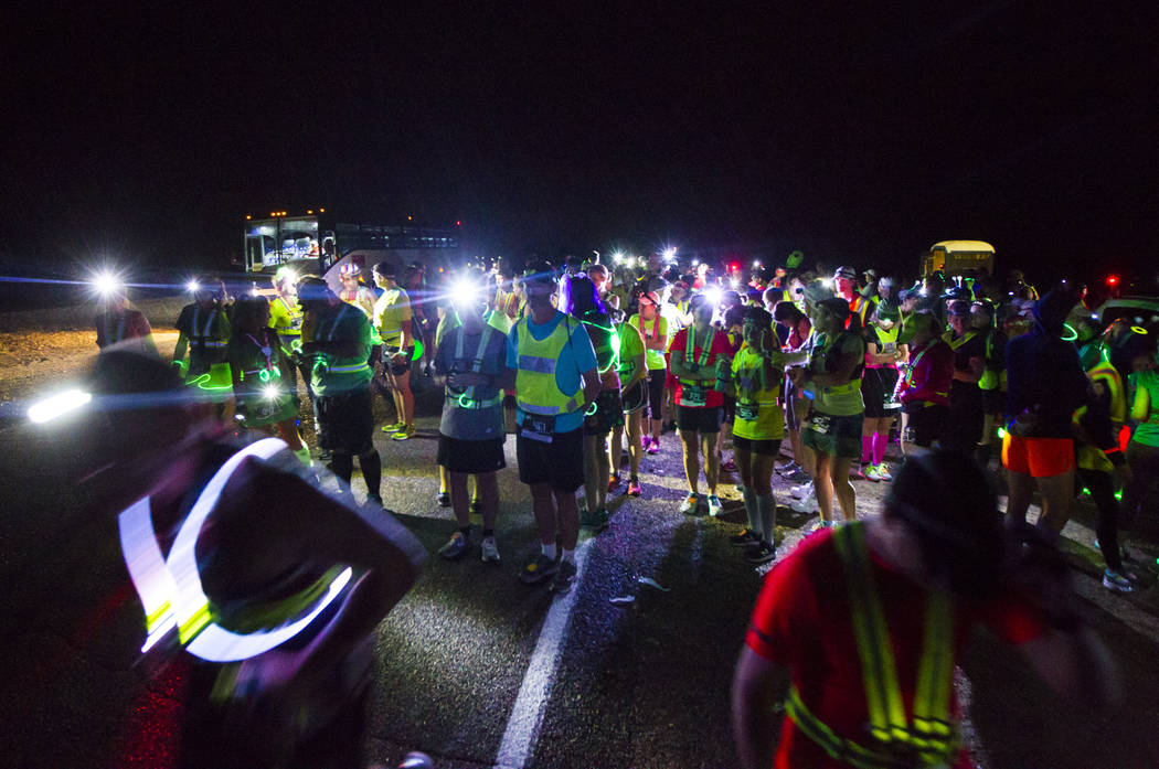 Participants prepare to compete in the half marathon during the Extraterrestrial Full Moon Midnight Marathon near Rachel on Saturday, Aug. 5, 2017. The event featured five distances ranging from 5 ...
