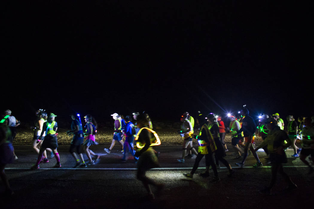 Participants compete in the half marathon during the Extraterrestrial Full Moon Midnight Marathon near Rachel on Saturday, Aug. 5, 2017. The event featured five distances ranging from 5k to 51k. ( ...
