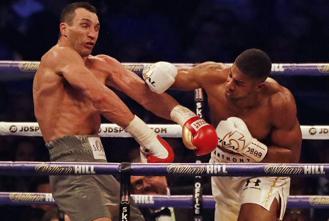 British boxer Anthony Joshua, right, fights Ukrainian boxer Wladimir Klitschko for Joshua's IBF and the vacant WBA Super World and IBO heavyweight titles at Wembley stadium in London, Saturday, Ap ...