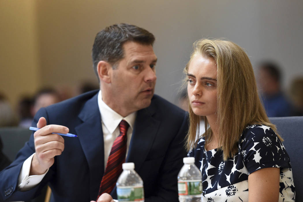 Defense attorney Joseph Cataldo, left, sits with Michelle Carter as the court hears testimony from Dr. Peter Breggin at her trial in Taunton, Mass., Monday, June 12, 2017. (Faith Ninivaggi/The Bos ...
