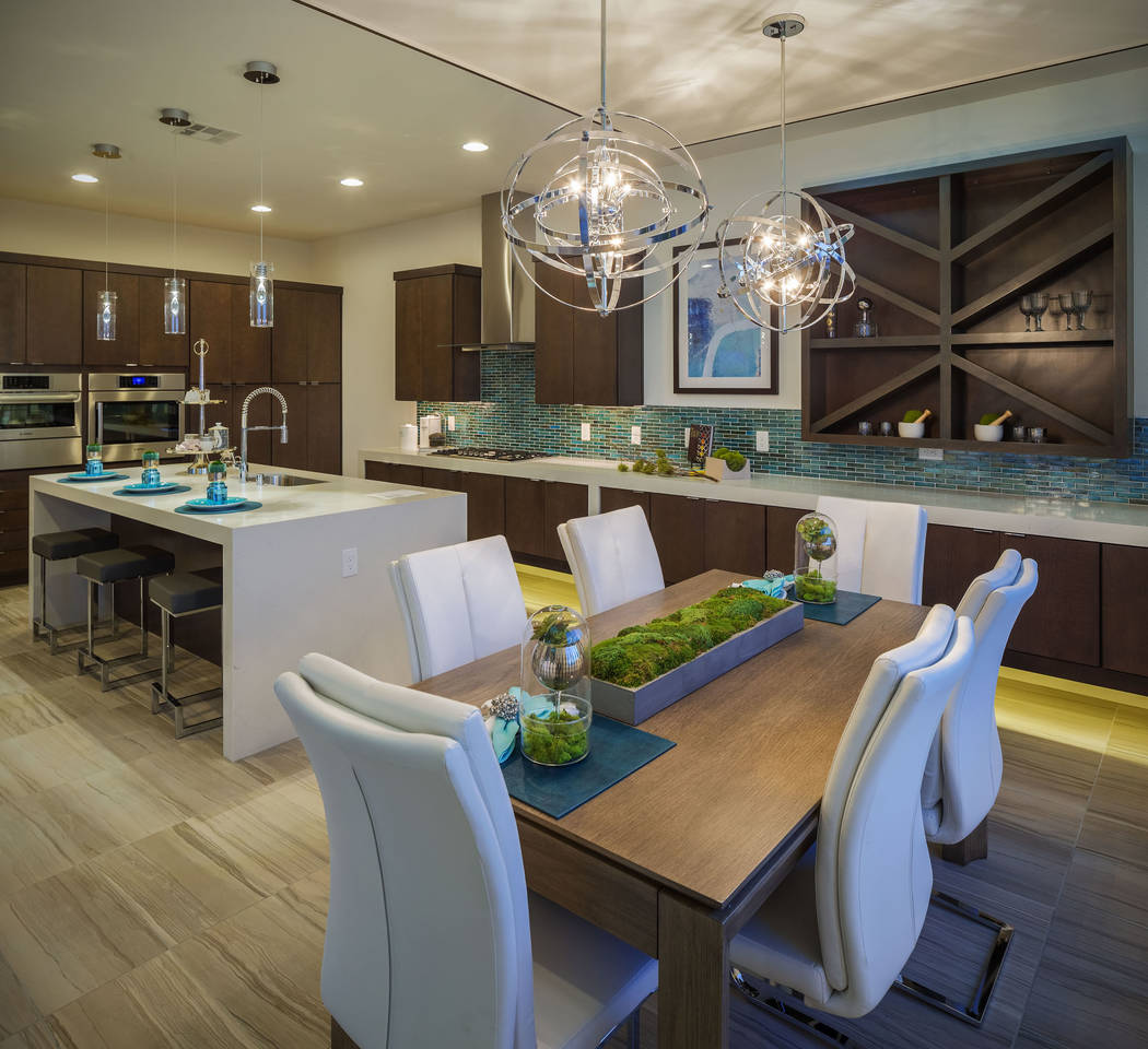 Woodside Homes' Biella model at Skystone neighborhood in Summerlin features an open island kitchen adjacent to a dining area and great room. (Smith Team at Keller Williams Las Vegas)