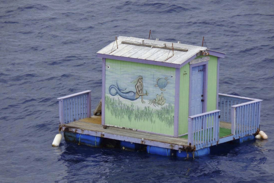 A tiny house with a mermaid on the side floats adrift in the Gulf of Mexico south of Grand Isle, La. on Wednesday, Aug. 2, 2017. The Coast Guard asks the public for any information regarding the d ...