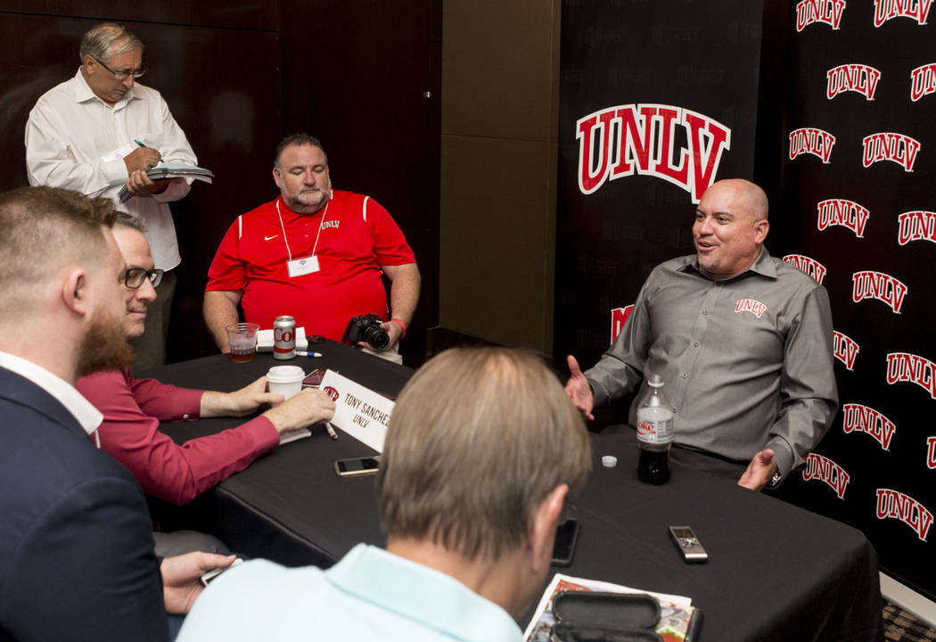 UNLV head football coach Tony Sanchez does an interview with multiple different print medias during the Mountain West Football Media Summit at the Cosmopolitan hotel-casino in Las Vegas, July 25,  ...