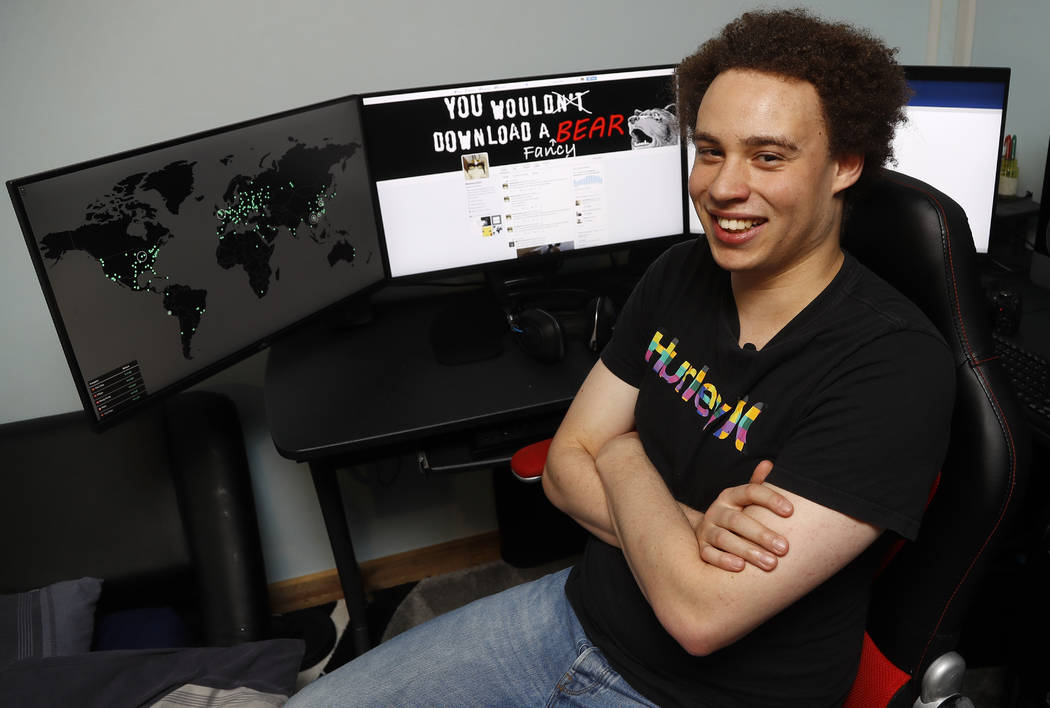 CORRECTS FROM HUTCHIS TO HUTCHINS -British IT expert Marcus Hutchins who has been branded a hero for slowing down the WannaCry global cyber attack, sits at his workstation during an interview in I ...
