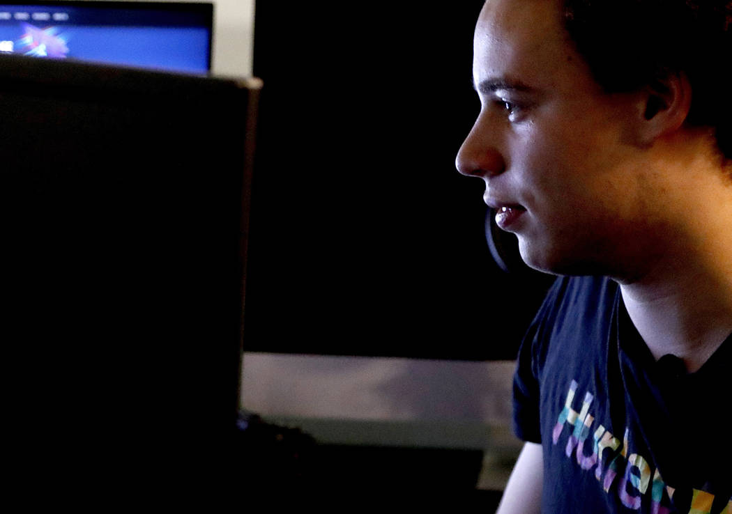 CORRECTS FROM HUTCHIS TO HUTCHINS -British IT expert Marcus Hutchins who has been branded a hero for slowing down the WannaCry global cyber attack, sits in front of his workstation during an inter ...
