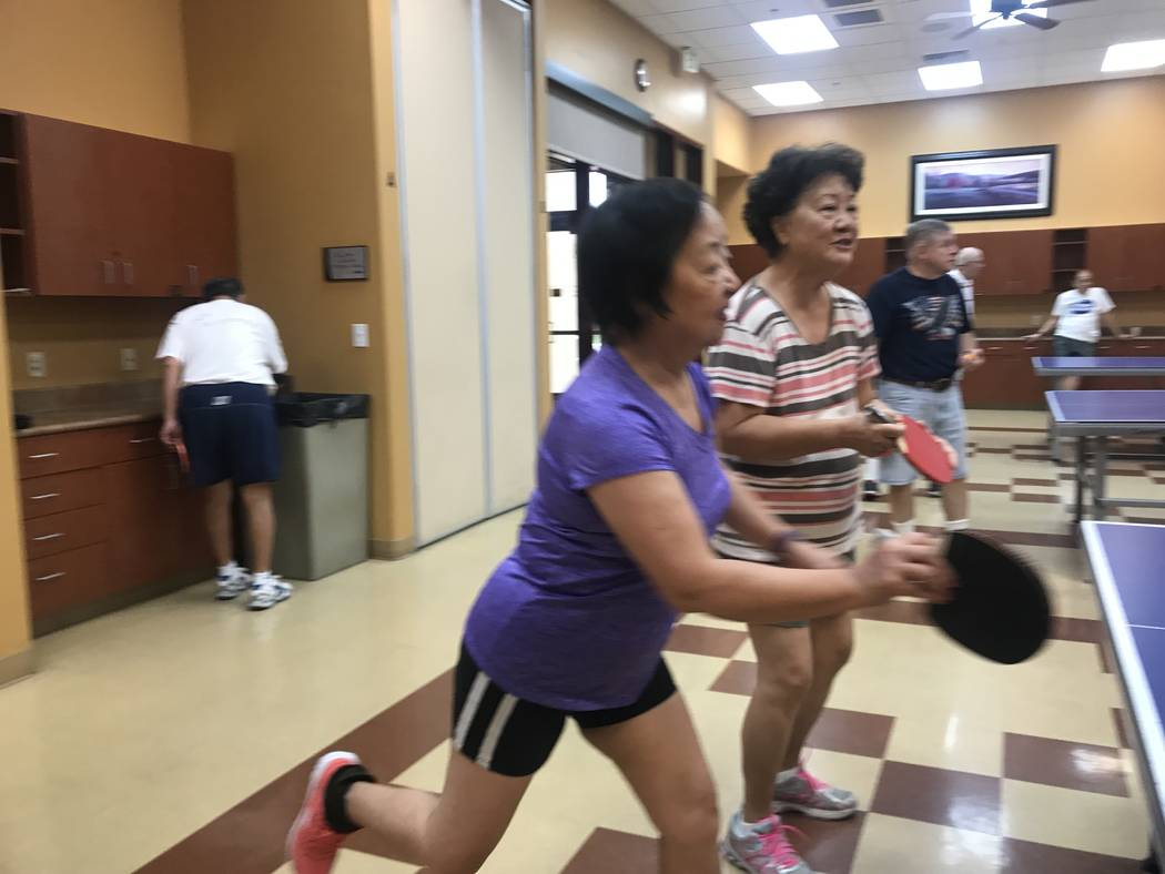 From left, Xiaoli Huang, 70, and Rosalind Wu, 76, play ping pong on July 3, 2017 at Sun City Aliante community center, 7390 N. Aliante Parkway. (Kailyn Brown/ View) @KailynHype
