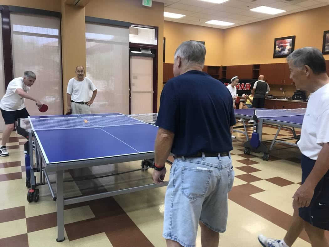 Members play ping pong on July 3, 2017 at Sun City Aliante community center, 7390 N. Aliante Parkway. (Kailyn Brown/ View) @KailynHype