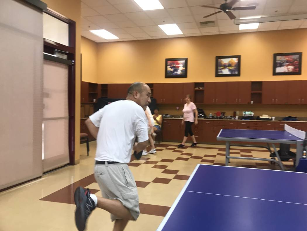 A member hits ping pong ball on July 3, 2017 at Sun City Aliante community center, 7390 N. Aliante Parkway. (Kailyn Brown/ View) @KailynHype