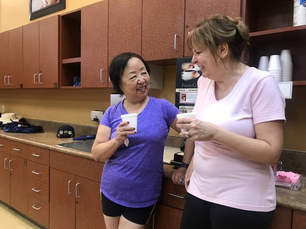 Xiaoli Huang and Susan Long take coffee break during ping pong game on July 3, 2017 at Sun City Aliante community center, 7390 N. Aliante Parkway. (Kailyn Brown/ View) @KailynHype