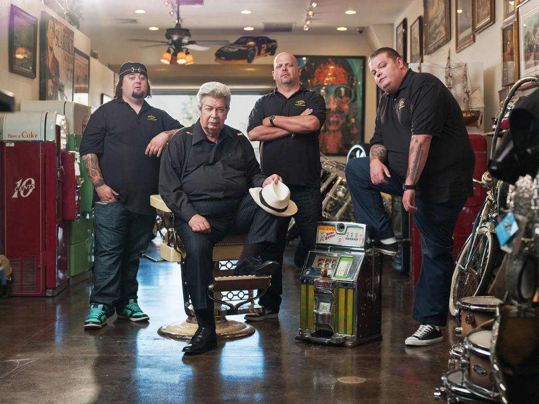 "From left, Austin ""Chumlee"" Russell, Richard Harrison, Rick Harrison and Corey Harrison star in History's ""Pawn Stars."" (History)"