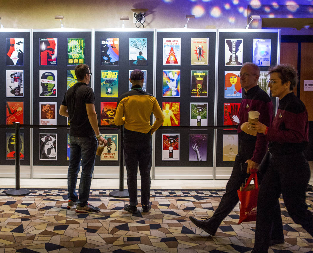 Star Trek fans look at posters during the Official Star Trek Convention at the Rio Convention Center on Thursday, Aug. 3, 2017.  Patrick Connolly Las Vegas Review-Journal @PConnPie