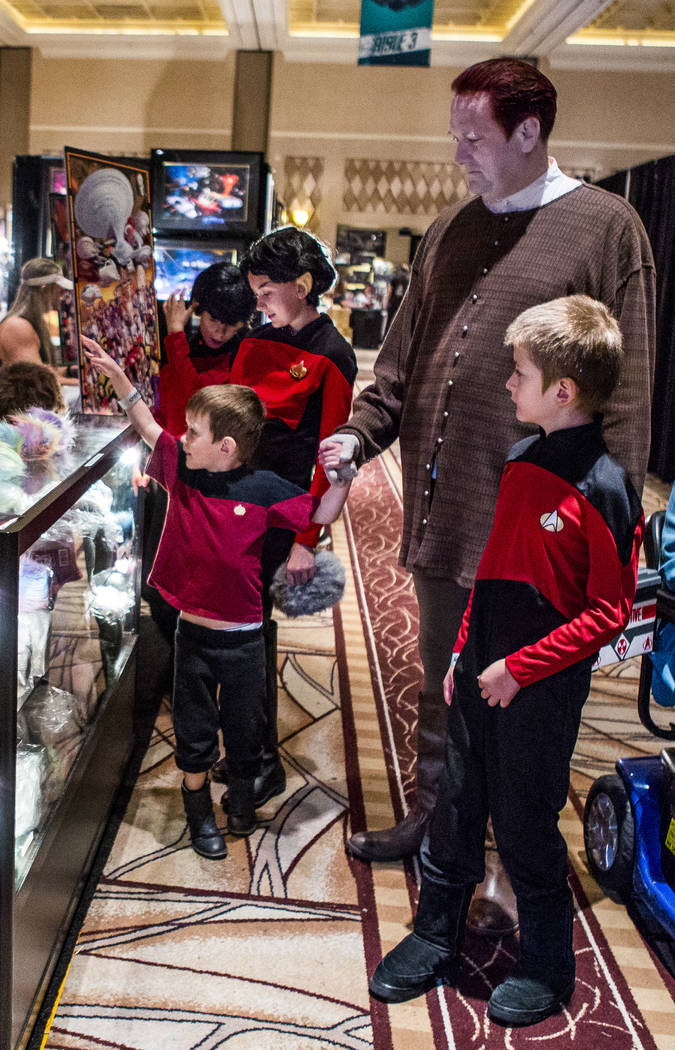 Eric Hall spends time with his children Allan, 10, right, Pheonix, 4, Celo, 11, and Spencer, 7, during the Official Star Trek Convention at the Rio Convention Center on Thursday, Aug. 3, 2017.  Pa ...