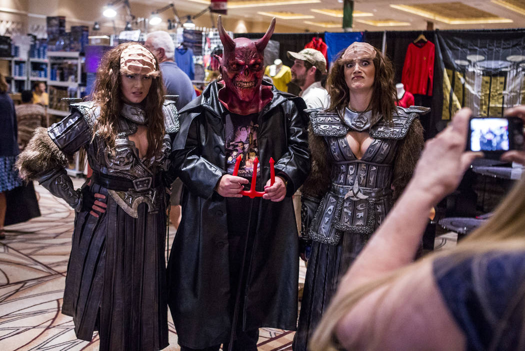 Juliane Dowell, left, and Alison Mingle, right, take a photo with a man who declined to give his name during the Official Star Trek Convention at the Rio Convention Center on Thursday, Aug. 3, 201 ...