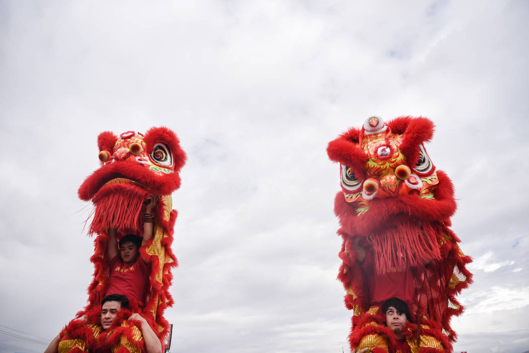 The Lion and Dragon Dancers of the Lohan School of Shaolinin participate in a traditional Chinese performance at the Shangai Plaza groundbreaking ceremony on Friday, August 4, 2017, in Chinatown i ...