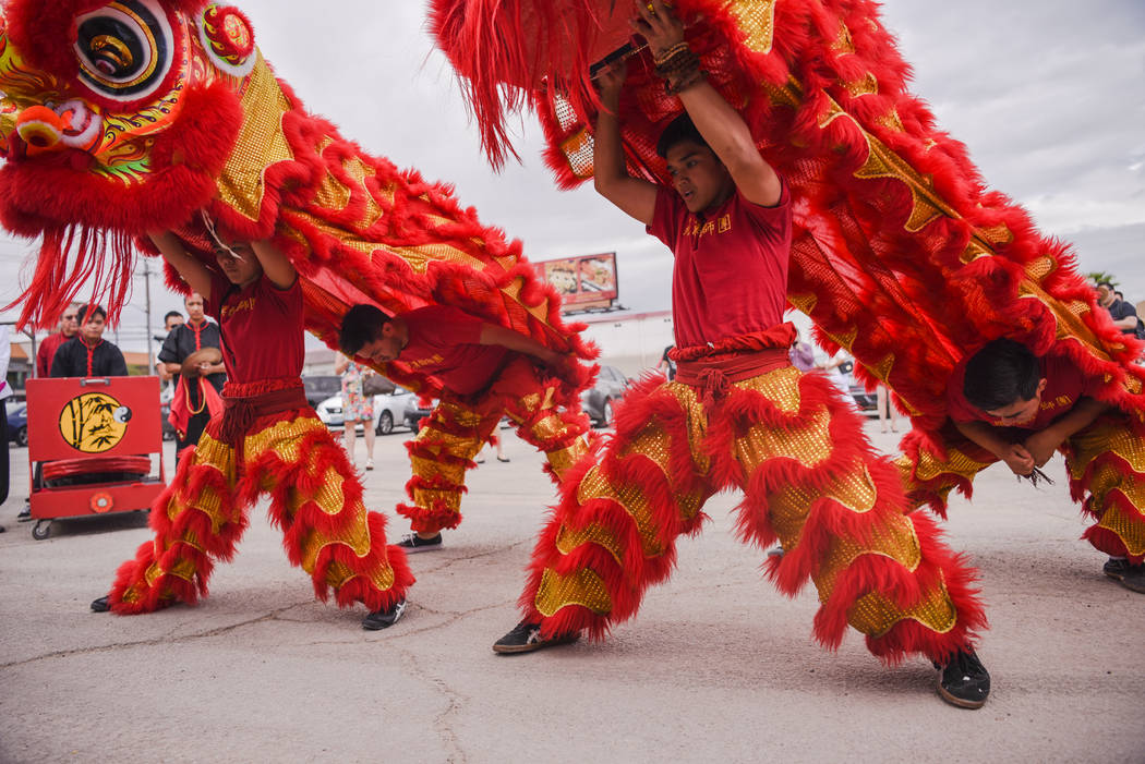 Mikael Candelaria, a dancer from the Lion and Dragon Dancers of the Lohan School of Shaolinin participates in a traditional Chinese performance at the Shangai Plaza groundbreaking ceremony on Frid ...