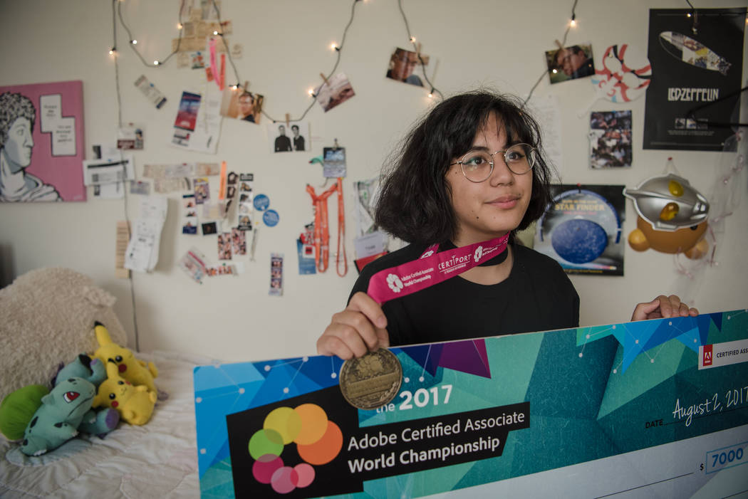 Kai Charvet in her bedroom with her championship medal and scholarship check on Friday, Aug. 4, 2017, in Las Vegas. Morgan Lieberman Las Vegas Review-Journal