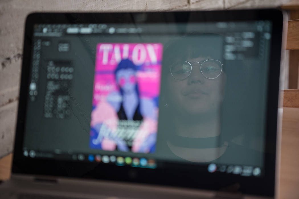 Kai Charvet is reflected in the computer screen while working on her computer at Serenade Coffee Bar and Desserts on Friday, Aug. 4, 2017, in Las Vegas. Morgan Lieberman Las Vegas Review-Journal