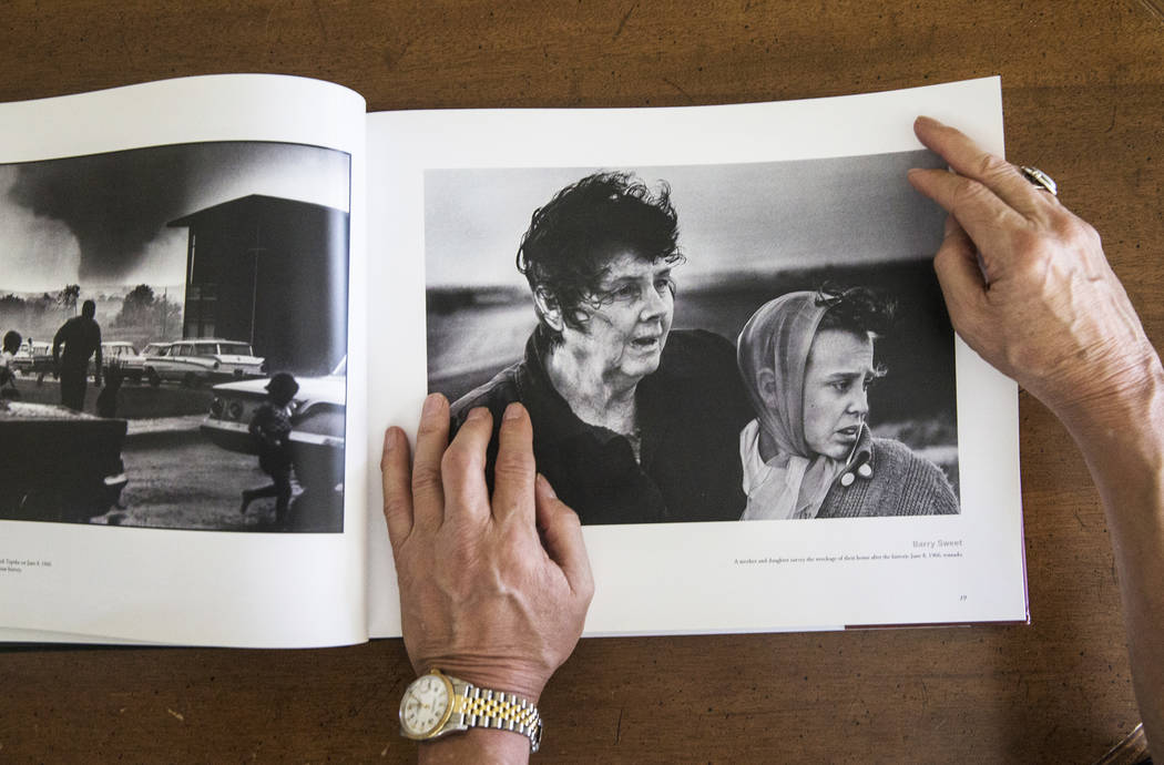 Photographer Barry Sweet looks at a collection of images from his time at the Topeka Capital-Journal on Tuesday, Aug 8, 2017, at Sweet's home, in Las Vegas. (Benjamin Hager/Las Vegas Review-Journa ...