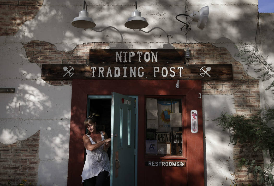 A woman leaves the Nipton Trading Post, Thursday, Aug. 3, 2017, in Nipton, Calif. American Green Inc., one of the nation's largest cannabis companies, announced it has bought the entire 80 acre Ca ...