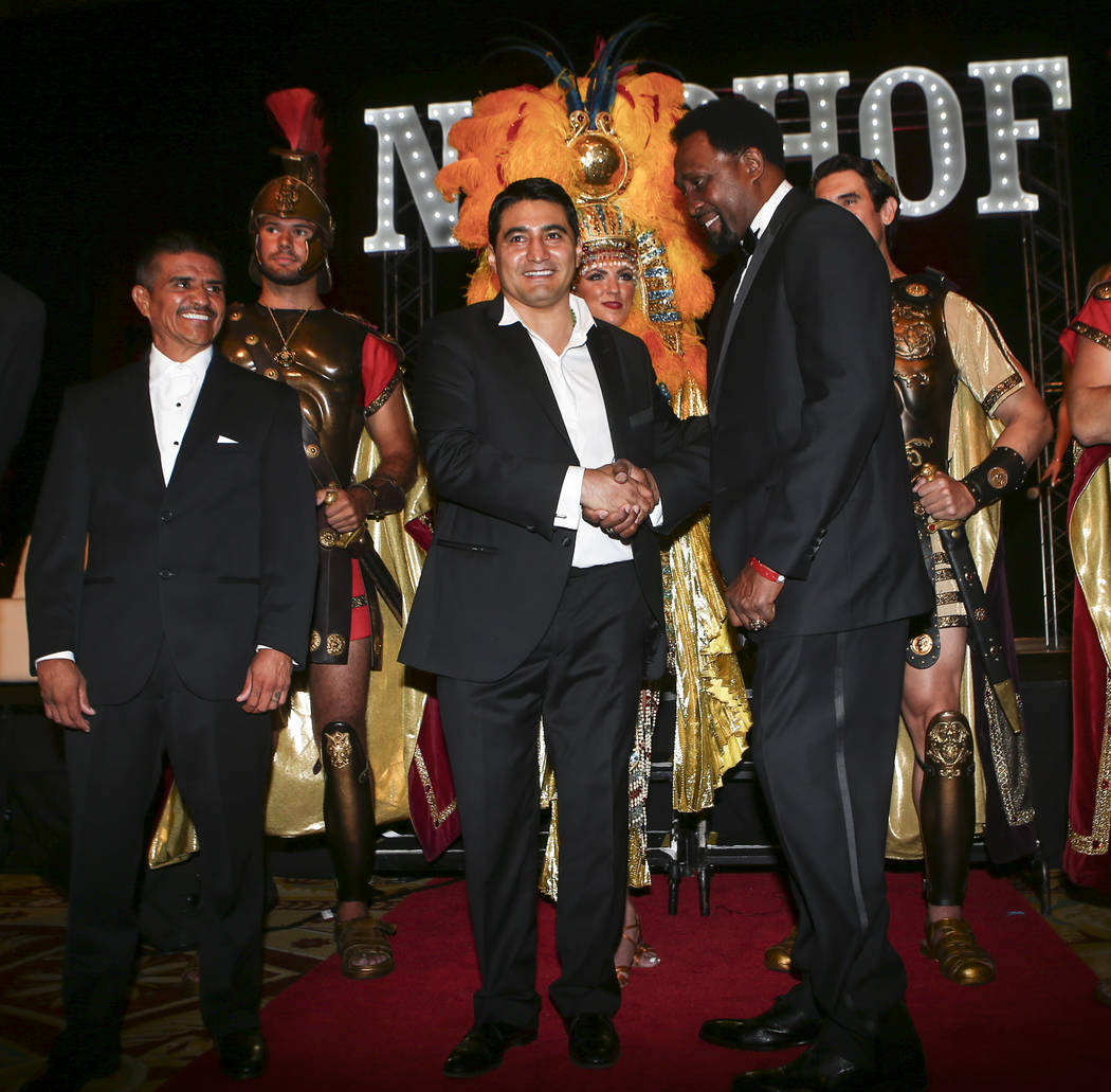 Thomas Hearns, far right, greets Erik Morales as Michael Carbajal, left, looks on at the start of the Nevada Boxing Hall of Fame class of 2017 induction ceremony and gala at Caesars Palace in Las  ...