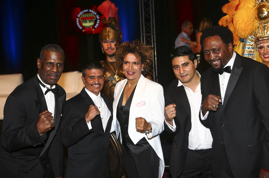 Boxers, from left, Michael Spinks, Michael Carbajal, Lucia Rijker, Erik Morales, and Thomas Hearns pose at the start of the Nevada Boxing Hall of Fame class of 2017 induction ceremony and gala at  ...