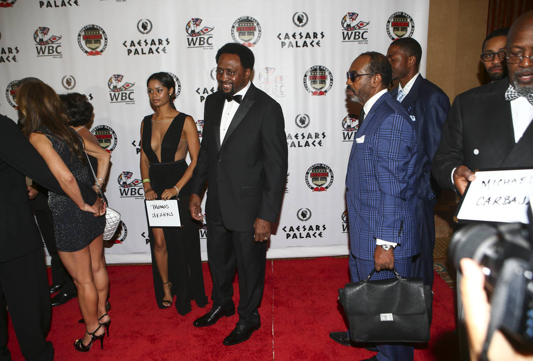 Boxer Thomas Hearns, center, arrives before being inducted into the Nevada Boxing Hall of Fame at Caesars Palace in Las Vegas on Saturday, Aug. 12, 2017. Chase Stevens Las Vegas Review-Journal @cs ...