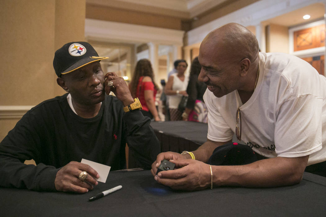 """Pernell """"Sweet Pea"""" Whitaker, left, talks to Darryl Flannigan, right, a training partner of his during a Fan meet-and-greet before the 2017 Nevada Boxing Hall of Fame ceremony in The Palace Ballro ..."""