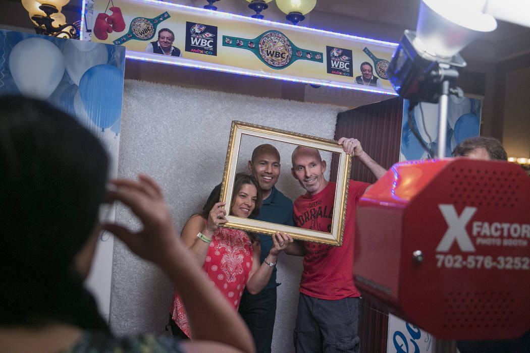 Jose Luis Castillo (center), two-time lightweight world champion,poses with fans at a photo booth during a Fan meet-and-greet before the 2017 Nevada Boxing Hall of Fame ceremony in The Palace Ball ...